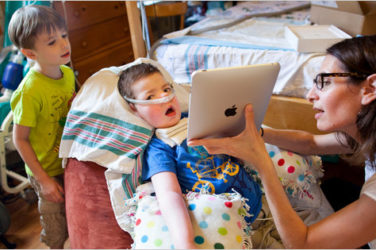 paraplegic boy uses ipad