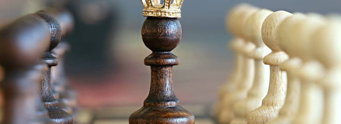 chess piece with crown on top