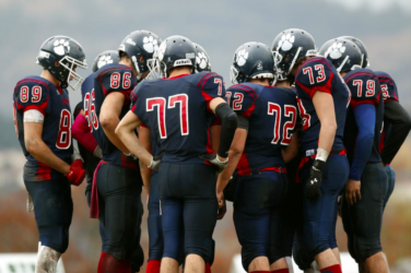 American football team in a huddle