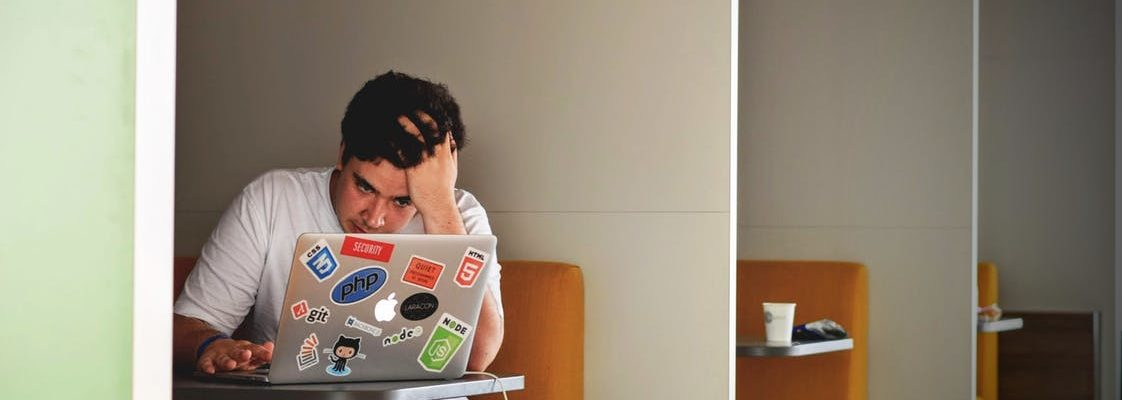 frustrated young man on a laptop