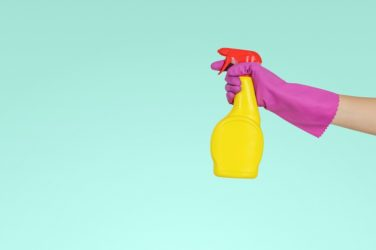 Person holding spray bottle